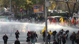 Tear gas and water cannons during demonstration in Footage
