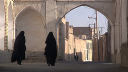Ladies in chadors walk through backstreets Yazd, I Footage