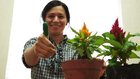 Female Gardener With Green Thumbs Up Live Action