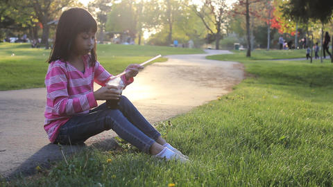 Little Girl Enjoys Her Cool Slushy At The Park Footage