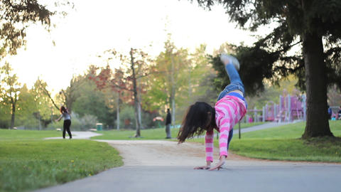 Girl Collapses After Doing Too Many Cartwheels stock footage