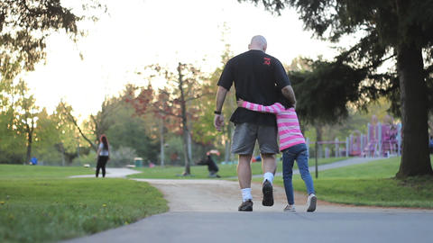 Father And Daughter Enjoy Walk At The Park Footage