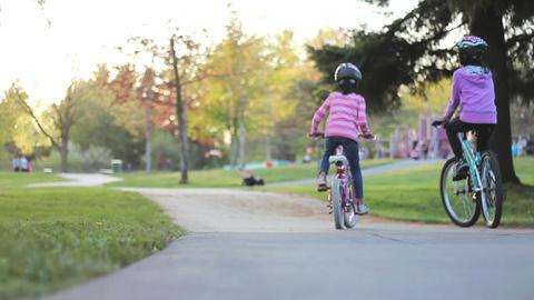 Girls Enjoying A Summer Bike Ride At Park Footage