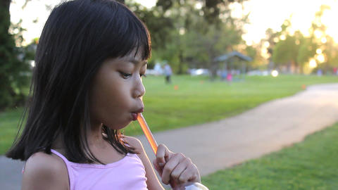 Eight Year Old Girl Enjoys Her Cool Slushy Drink Live Action