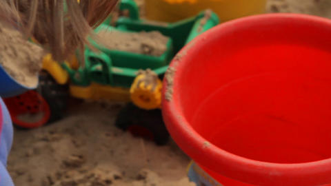 Little Girl Playing In A Sandbox (People) Footage