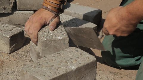 Construction worker cleaning bricks Footage
