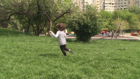 Two Little Girls Playing Catch In The Park With Th Footage