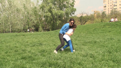 Two Little Girls Playing In The Park With They're  Footage