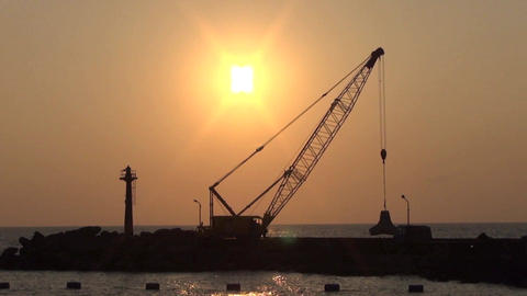 The Silhouette Of Under Construction At Coast stock footage