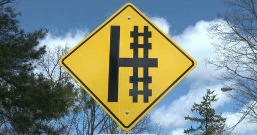 Cross sign close to railway tracks Footage