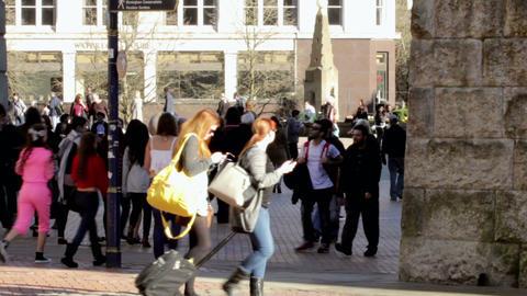 People walk on Victoria Square in Birmingham, UK Footage