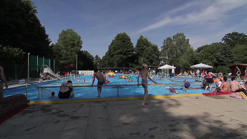 People At The Swimmingpool stock footage