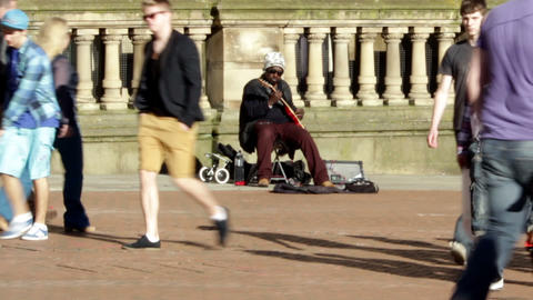 Black street artist playing electric guitar on the Footage
