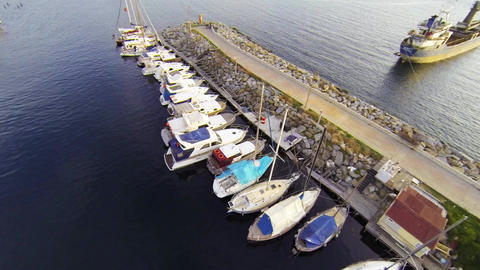 Flying over sailing boats and luxury yachts Footage