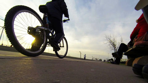 Two young cyclists silhouette at sunset Footage