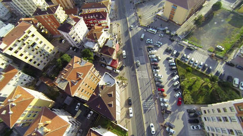 Overhead right pan across roofs, houses and cars Footage