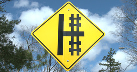 Cross Sign Close To Railway Tracks stock footage