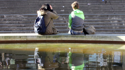 Lonely couple sitting on the edge of fountain 2 Footage
