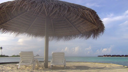 Beautiful Tropical Beach With Two Chairs Under An  stock footage