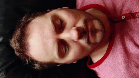 Sleeping guy wakes up scared Footage