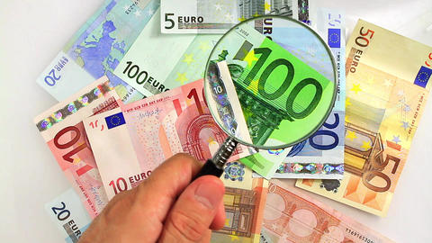 Magnifying Glass Over Money stock footage