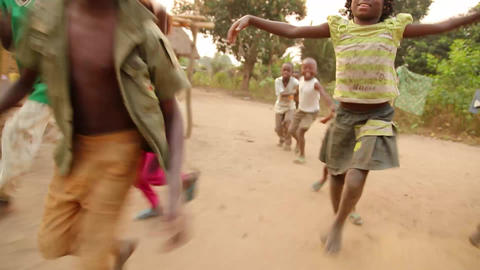 Kids Running In Village Bwe, Democratic Republic O stock footage