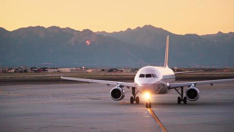 Plane leaving sunrise Footage