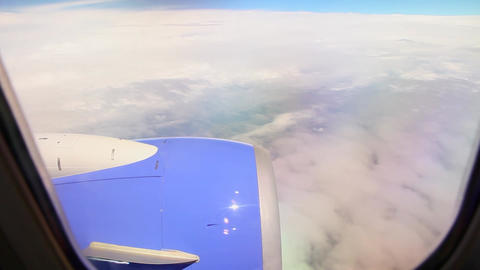 Airplane engine and clouds Live Action