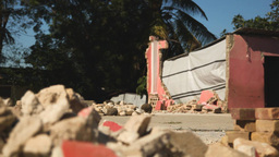 Earthquake Haiti rubble dolly shot tight Footage
