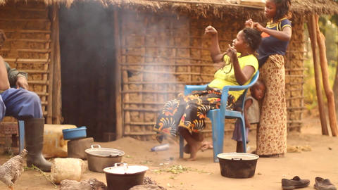 Village life braiding hairBwe, Democratic Republic Footage