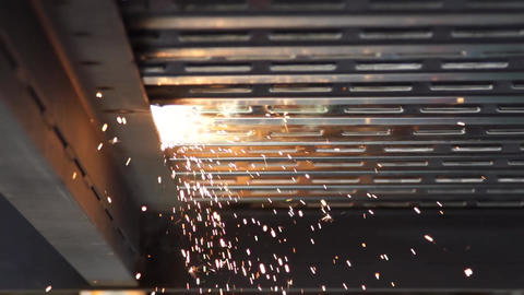 Welding sparks sideways super slow motion Footage