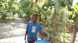 Boy pushed buckets from water well Live Action