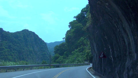 driving on the mountain road and tunnel .time laps Footage