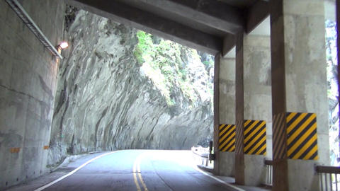 driving on the mountain road and through tunnel of Footage