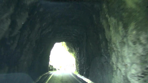 driving on the mountain path and tunnel of rock Footage