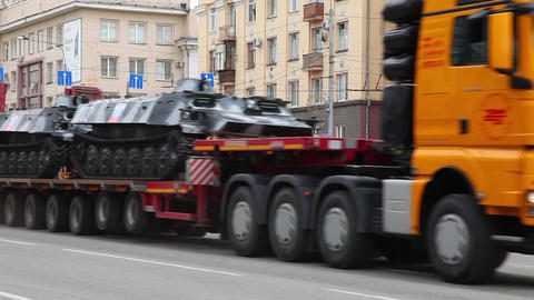 Car carries a trailer two military tracked transpo Footage