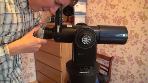Astronomer sets the camera to the telescope Live Action