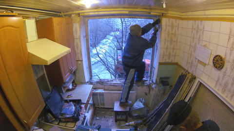 Workers replace the window the old to the new. Tim Footage