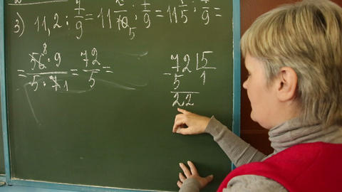 Mathematics Teacher In The Class At The Board stock footage
