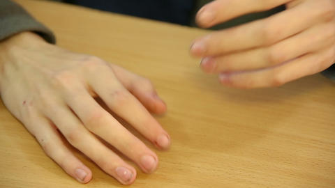 Hands of a young man on the Desk Footage