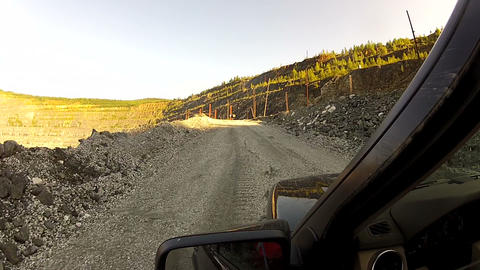 Access by car along the mountain career Footage