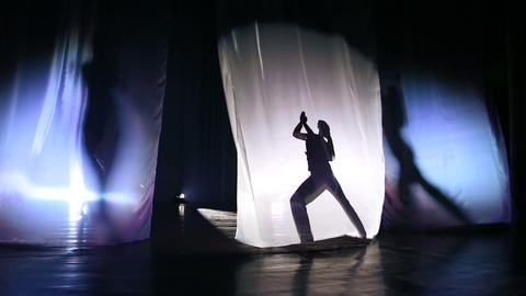 Silhouette, shadow dancing girls on stage Footage