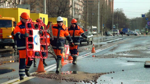 Workers install a fence on flooded street Footage
