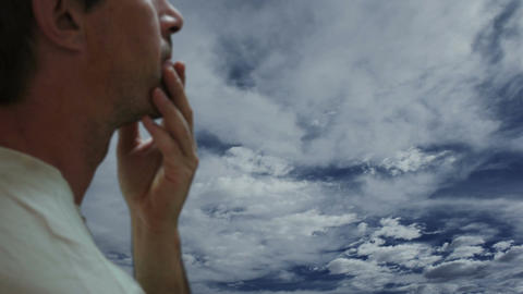 Concerned Man Against Timelapse Clouds Footage