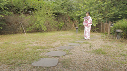 Oriental Woman In Kimono Walking Down A Path In Ja stock footage