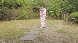 Oriental woman in kimono walking down a path in Ja Footage