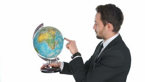 Businessman spinning a globe Footage
