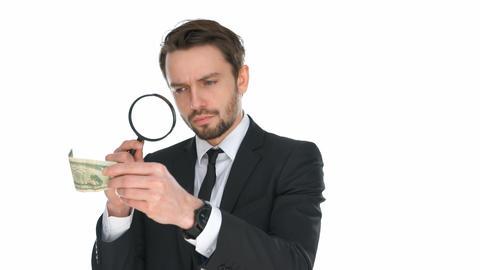 Businessman examining a banknote ビデオ