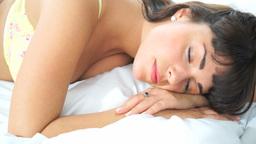 brunette sleeping in her bed Footage