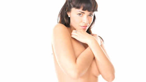 Naked woman covering breasts Footage